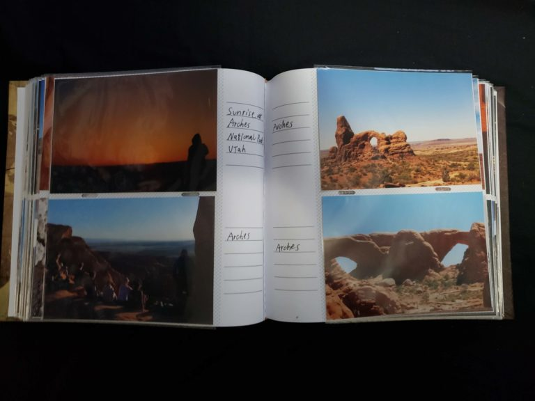 Inside the 6x4 photo album, with 2 pictures on each page and a caption